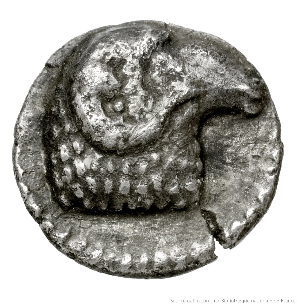 Εμπροσθότυπος 'SilCoinCy A4443, Fonds général, acc.no.: . Silver coin of king Evelthon's successors of Salamis 500 - 478 BC. Weight: 0.88g, Axis: 2h, Diameter: 10mm. Obverse type: ram's head right. Obverse symbol: -. Obverse legend: - in -. Reverse type: Ankh, the ring formed of pellets ranged about a linear circle; in circle, cypriot syllabic sign.. Reverse symbol: -. Reverse legend: ku in Cypriot syllabic.