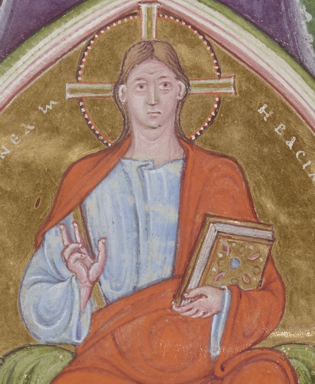 Jesus holds a book